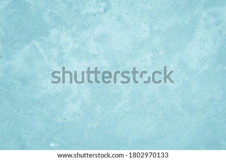 Photo of  Pastel Blue and White concrete stone texture for background in summer wallpaper. Cement and sand wall of tone vintage. Concrete abstract wall of light cyan color, cement texture background for design.