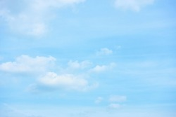 Pastel blue sky with clouds - abstract background