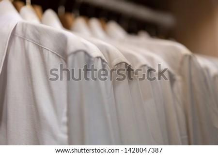 Pastel Clothes. Clothes on Open Clothes Rail