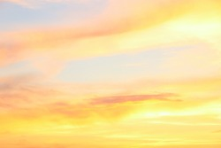 Pastel clouded sky on the sunset in yellow and orange colors