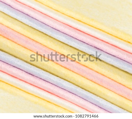 Pastel Color Fabric Background or Texture. Stack of Folded New Soft Color Cloth. Absorbent Microfiber Towels with Place for Text #1082791466