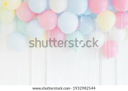 Pastel colored balloons on a white wall Foto stock ©