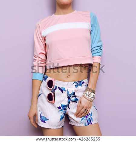 Pastel colored clothing. Summer trend. Stylish fashion Girl.