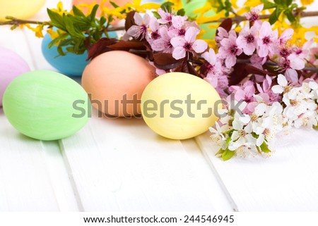 Pastel colored Easter eggs next to blooming branch #244546945