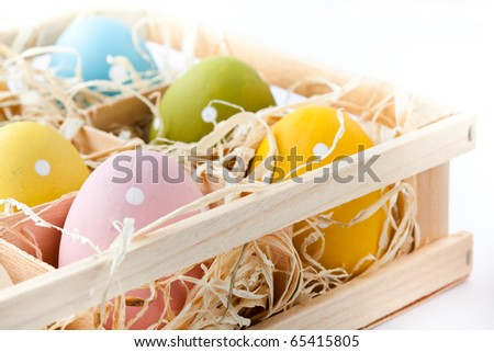 Pastel colored Easter eggs on a white background. Small DOF.
