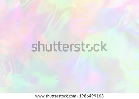 Pastel colored holographic gradient background.Holographic abstract soft colors texture. Holographic foil iridescent backdrop.