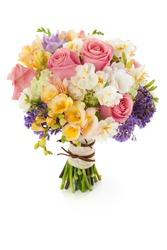 Pastel colors wedding bouquet made of Roses, Freesia, Carnation and Limonium flowers isolated on white.