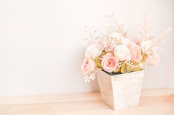 Pastel Coloured Artificial Pink Rose Wedding Bridal Bouquet in flower pot with soft vintage tone