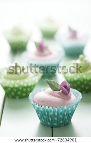 pastel coloured cupcakes, shallow dof