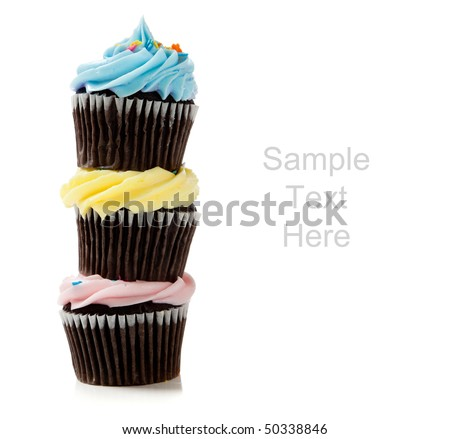 Pastel cupcakes including blue, pink and yellow on a white background with copy space