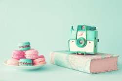 Pastel french macarons and vintage photo camera