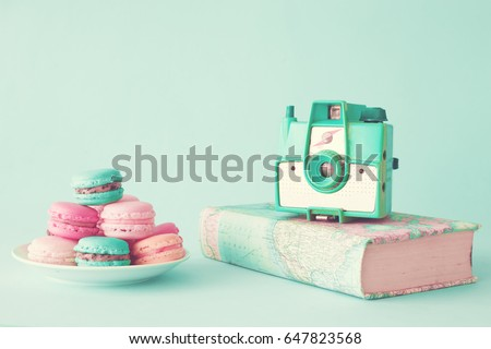 Pastel french macarons and vintage photo camera #647823568