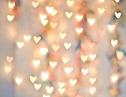 Pastel Heart Bokeh on a Pale Background