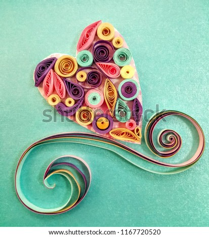 Pastel heart made quilling on a light background.   #1167720520