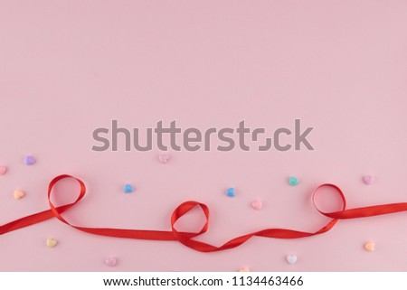 Pastel heart pattern decorate with red ribbon on pink background with copy space #1134463466