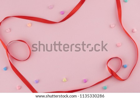 Pastel heart pattern decorate with red ribbon on pink background with copy space #1135330286
