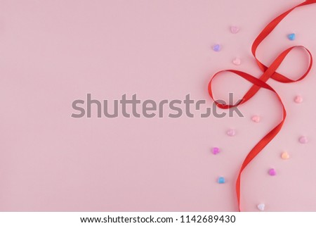 Pastel heart pattern decorate with red ribbon on pink background with copy space #1142689430