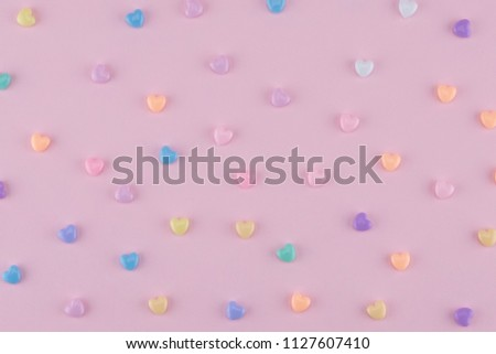Pastel heart pattern on pink background #1127607410