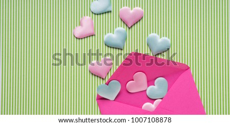 Pastel hearts flying off pink envelope. Valentine's day concept #1007108878