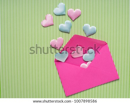 Pastel hearts flying off pink envelope. Valentine's day concept #1007898586