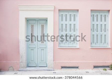 Pastel pink building with light blue door and marble in Athens Greece #378044566