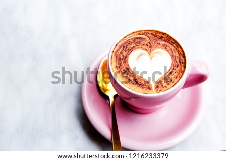 Pastel pink cappuccino cup with heart latte art. Coffee on the marble background with ornamental floor #1216233379