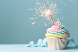 Pastel rainbow birthday cupcake with sparkler