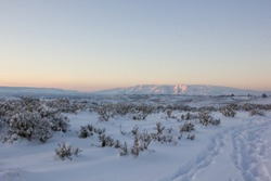 Pastel sundown over Mt Clemens in Naches, Washington across a snowy canyon.