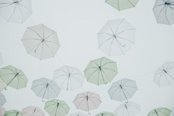 pastel tone Colorful umbrellas background. Colorful umbrellas in the sky