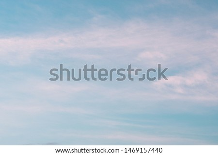 Pastel tone of evening cloud and sky before sunset. Peaceful sky in calm atmosphere. A fluctuation weather make a dreamy and imaginative cloudscape.