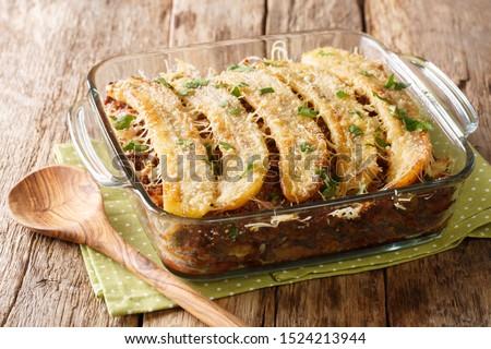 Pastelon de Platano Maduro is a close-up of banana lasagna in a baking dish on the table. horizontal Foto stock ©