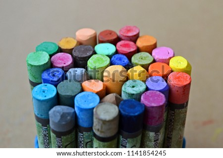 Pastels. Oil pastels. Colorful pastels. Art supplies. Child play. Education. Text: oil pastels. #1141854245