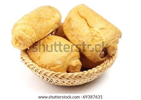 pasties with sausages in wattled basket