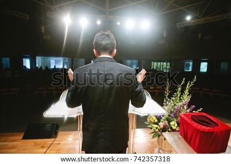 Pastor praying for congregation Stok fotoğraf ©