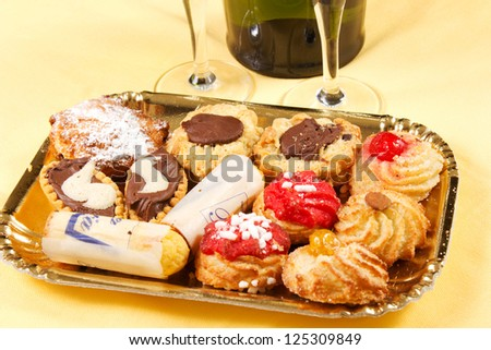 pastries and cookies on a table with champagne