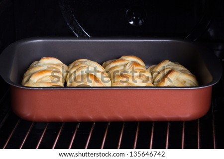 pastries with apple jam in hot oven