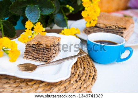 Pastries with poppy with cup of coffee. Nice spring breakfast. Stok fotoğraf ©