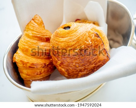 Pastry, croissant, and danish bread on ceramic white dish in luxury hotel Foto stock ©
