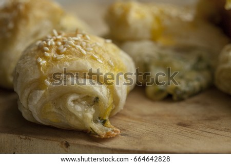 Pastry from puff pastry with cheese filling. Selective focus #664642828