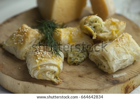 Pastry from puff pastry with cheese filling. Selective focus #664642834