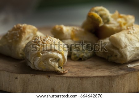 Pastry from puff pastry with cheese filling. Selective focus #664642870
