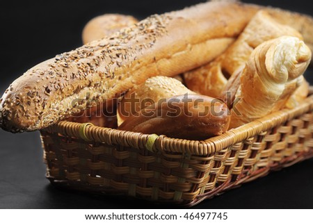 Pastry in wicker basket against dark background selective focus