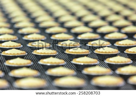 Pastry. Pastry on a conveyor. A lot of cookies.