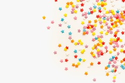 pastry sprinkling on a white background, sprinkling for Easter cake, colored background, sprinkling in the form of stars