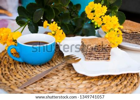 Pastry with poppy with cup of coffee. Nice spring breakfast. Traditional tajil katlama pie. Stok fotoğraf ©