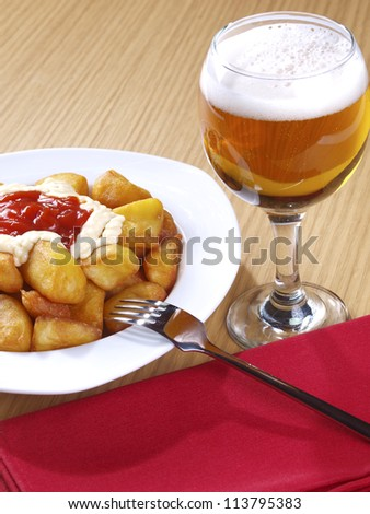 Patatas Bravas � Hot spicy fried potatoes �Patatas Bravas�,  Fried potatoes served with mayonnaise and a hot spicy sauce. Spanish Tapa. �Tapas� are typical spanish appetizer.