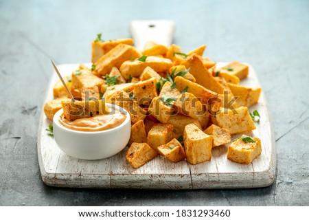 Patatas bravas traditional Spanish potatoes snack tapas on white wooden board Photo stock ©