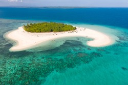 Patawan island. Small tropical island with white sandy beach. Beautiful island on the atoll, view from above. Nature of the Philippine Islands.