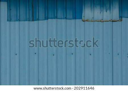 Patched Corrugated Metal Sheet with Navy Blue and Powder Blue