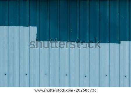 Patched Corrugated Metal Sheet with Navy Blue and Powder Blue Color
